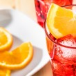 Top of view of glass of spritz aperitif aperol cocktail with orange slices and ice cubes — Stock Photo #72937605