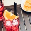 Glasses of spritz aperitif aperol cocktail with orange slices and ice cubes — Stock Photo #72959531