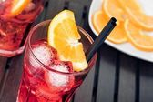 Close-up of view of glasses of spritz aperitif aperol cocktail with orange slices and ice cubes — Stock Photo
