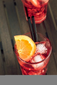 Spritz aperitif aperol cocktail with orange slices and ice cubes — Stock Photo