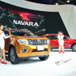 Постер, плакат: NONTHABURI DECEMBER 1: Model Poses with New Nissan Navara NP 3
