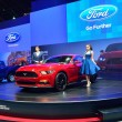 Постер, плакат: NONTHABURI DECEMBER 1: Model Poses with Ford Mustang 2 3L ecob