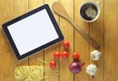 Food recipe preparation on tablet — Stock Photo