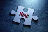 Time print on jigsaw puzzle — Stock Photo