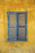 Old faded blue and yellow rustic window  — Stock Photo