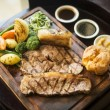 Traditional english food sunday roast lunch in restaurant — Stock Photo #65134779