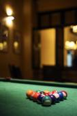 Pool balls on billiards table in cozy bar — Stockfoto