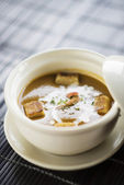 Prawn soup with croutons and cream — Stock Photo