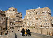 Veiled women walking  in sanaa old town in yemen — Stock Photo
