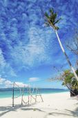 Puka beach name sign in boracay island philippines — Stock Photo
