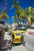 Trike moto taxis on boracay island main road in philippines — Stock Photo