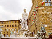 Retro look Fountain of Neptune in Florence — Stock Photo