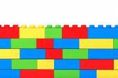 Wall from children plastic blocks — Stock Photo