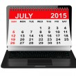 July 2015 calendar over laptop screen — Stock Photo #74024037
