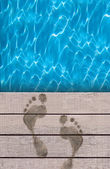 Swimming pool and wooden deck ideal for backgrounds — Stockfoto