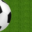 Soccer ball over green grass background — Stock Photo #65582125