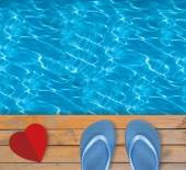 Swimming pool with blue clear water, wooden deck and red paper h — Stock Photo