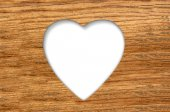 Wood texture with cut heart background — Stock Photo