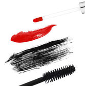 Stroke (sample) of black mascara and lip gloss, isolated on whit — Stock Photo
