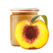 Jar of baby puree and half of fresh peach isolated on white — Stock Photo #68490349