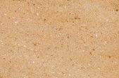Желтый песок фон — Стоковое фото