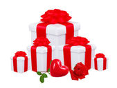 Gift boxes with red bow and red rose isolated on white — Stock Photo