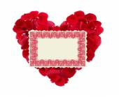 Beautiful heart of red rose petals and greeting card isolated on — Stock Photo