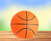 Basketball ball on the table over bight nature background — Stock Photo