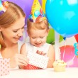 Happy birthday. mother giving gift to his little daughter with balloons — Stock Photo #51880471