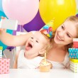Happy children's birthday. selfie. mother photographed  her daughter the birthday child with balloons, cake, gifts — Stock Photo #52085961