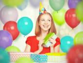 Happy girl celebrating birthday with balloons and gifts — Stock Photo