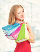 Happy woman with bag on a shopping in the mall — Стоковое фото