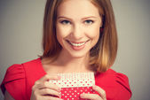 Beauty girl in red dress with gift box to birthday or Valentine's Day — Stock Photo