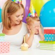 Children's birthday. mom, baby daughter, balloons, cake, gifts — Stock Photo #52520295