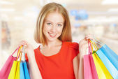 Happy woman with bag on a shopping in the mall — Stockfoto