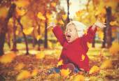 Happy little child, baby girl laughing and playing in autumn — Stock Photo