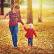 Happy family mother and child little daughter on autumn walk — Stock Photo #54520203