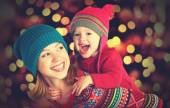 Happy family mother and little daughter playing in the winter for Christmas — Stock Photo