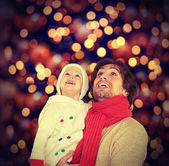 Happy family and a Christmas miracle — Stock Photo
