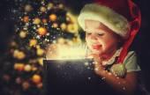 Christmas miracle, magic gift box and child baby girl — Stock Photo