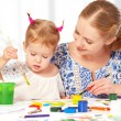 Mother and child daughter draw paints — Stock Photo #58999259