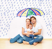 Concept: social protection of family. family took refuge from  miseries and rain under umbrella — Stock Photo