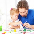 Happy family father and child baby daughter together draw paints — Photo #59802133