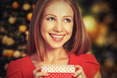 Beauty girl in red dress with gift box to Christmas or Valentine's Day — Stock Photo