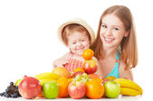 Happy family mother and daughter little girl, eat healthy vegetarian food,  fruit isolated — Stock Photo