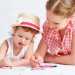 Mother and baby daughter together paint — Stock Photo #69903997