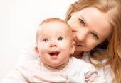 Happy family mother and baby daughter hugging — Stock Photo