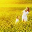 Happy family, mother and child l little daughter running  on mea — Stock Photo #75924381