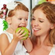 Happy family mother and child with healthy food fruits and veget — Stock Photo #76227855