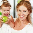 Happy family mother and child with healthy food fruits and veget — Stock Photo #76227883